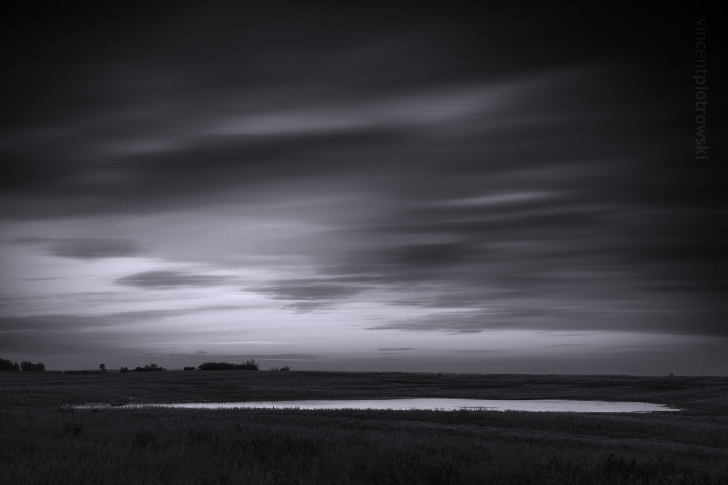 A longer exposure during a windy day on the prairies giving the photo an almost abstract feel