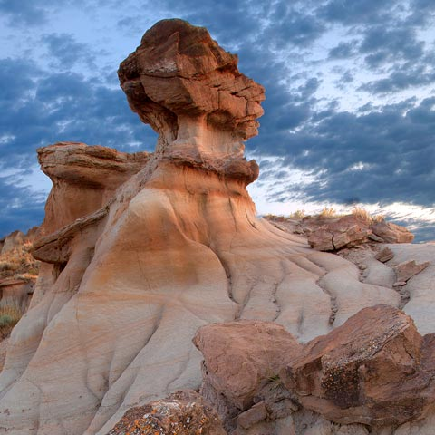 A picture of a hoodoo and rocks taken in Dinosaur Provincial Park at sunrise