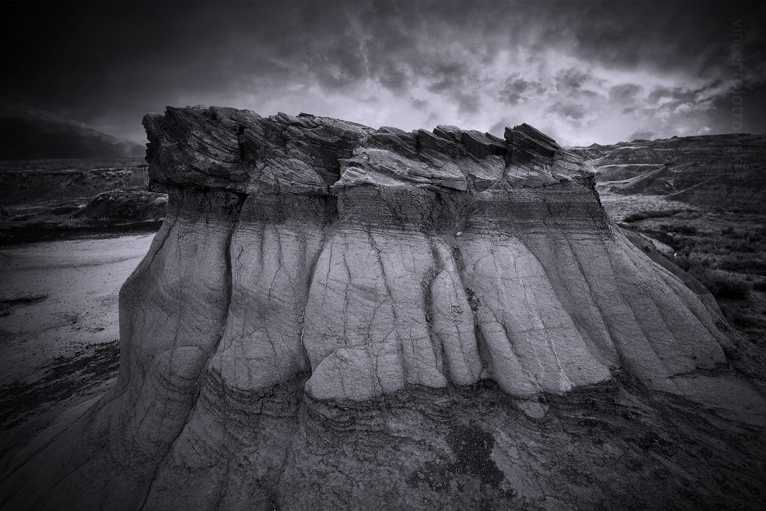 A picture of a hoodoo and rocks taken in Dinosaur Provincial Park and captured in black and white
