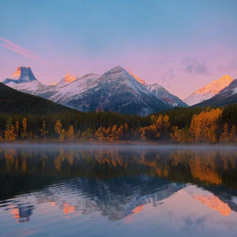 Wedge mountain in the Fisher Range at sunrise taken from Wedge Pond in Spray Lake Provincial Park (part of Kananaskis Country).