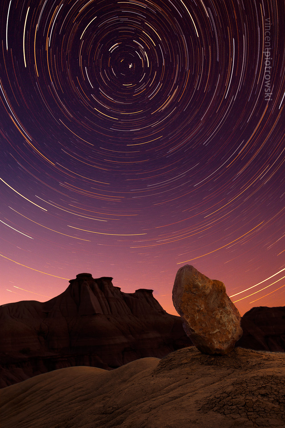 A star trail shot with a minimalist composition taken in Dinosaur Provincial Park Alberta using a long exposure
