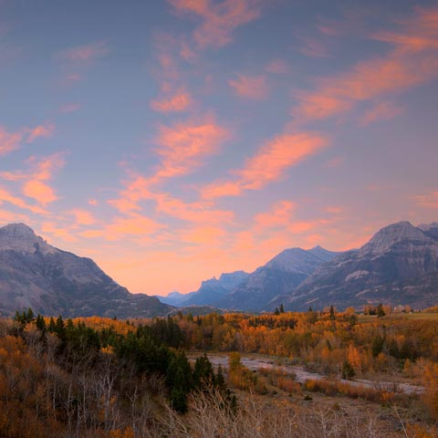 Looking South in Waterton National Park at the Price of Wales Hotel during sunrise in the Fall.